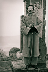 Holy Hiker (davidkoiter) Tags: old mountain man david art monument look stone canon walking lens eos 50mm prime artist robe antique walk top f14 buddhist south pillar peak monk jo korea age 7d wise marker brave stick desaturated aged mm usm split wisdom 50 stern tone ef bravery jang treatment desaturate toning stoic keon geon koiter musangsa davidkoiter hyangjeoksan