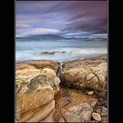 (David Panevin) Tags: longexposure morning sky bw seascape beach water clouds landscape rocks australia olympus tasmania e3 beforesunrise tranmere sigma1020mmf456exdchsm bwnd davidpanevin