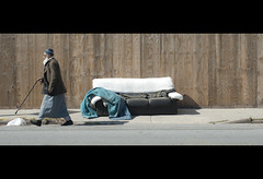 a bag, a man, & a couch. (Vitaliy P.) Tags: street new york city nyc white man black macro green film leather cane fence bag movie walking beard island wooden boards nikon bars long top candid homeless wide couch plastic sidewalk queens blanket micro lic gothamist 60mm cinematic sunnyside f28 d80 midstep vitaliyp