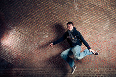 Jump (364/365) (Ivo Noppen) Tags: bridge portrait urban brown selfportrait colour wall tile europe pattern belgium ghent project365 strobist ivographycom 3652010