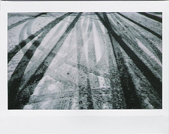 Snowy Streets (Nick Leonard) Tags: road street vegas winter snow film weather fuji lasvegas nevada nick wide tracks 200 snowday tiretracks instax treadmarks instantfilm fujiinstax200 nickleonard january2011