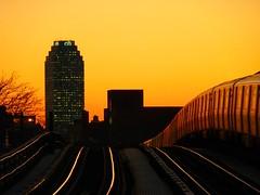 Heading Into the Sunset (Roblawol) Tags: newyorkcity sunset newyork train subway glow dusk tracks astoria mta citibank ntrain longislandcity qtrain citi citibuilding 2011 astoriablvd january4 010411