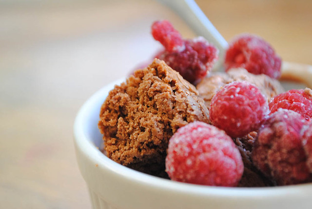 chocolate ice cream with frozen raspberries and brownie bits