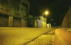 Sardine St. Terminal Island (brian-moore) Tags: street night canon availablelight 200asa warehouse deserted sanpedro terminalisland t50 memoriesfilm sardinestreet