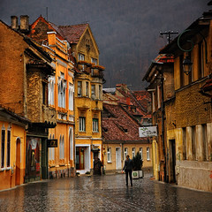 "Rainy Day (George Nutulescu) Tags: street old city travel reflection history town downtown gloomy expression medieval rainy romania older hdr brasov magicalmoments kronstad paragon nikond40 concordians vertorama ""flickraward"" imagesforthelittleprince redmatrix sailsevenseas goldsealings virgiliocompany outstandingromanianphotographers abokehoflight architerctural"