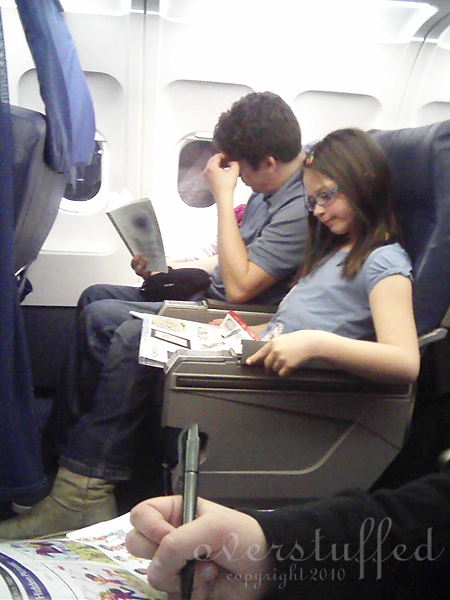Bria and Joel and Chloe on the plane