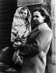 Life in the Refugee Camp (UNHCR Central Europe) Tags: winter camp portrait blackandwhite bw woman baby austria europe hungary child refugee mother accommodation emergency assistance unhcr hungarian barack magyarország refugeecamp hungarianrevolution menekült európa hungarianrefugees woodenbarack 1951revolution