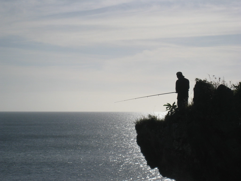 Fisherman, Balangan headland, Bukit, Bali, Indonesia
