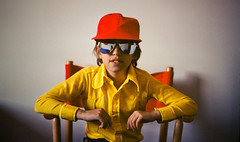 Mimi (Imapix) Tags: red portrait reflection sunglasses yellow vintage chair slide 70s