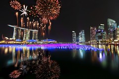 Singapore New Year Countdown 2011 Fireworks : First Burst : (Kenny Teo (zoompict)) Tags: light sky reflection building tourism water beautiful skyline architecture night canon wonderful lens landscape photo yahoo scenery photographer waterfront view walk dramatic firework tourist best midnight getty cbd 12  explosive mbs newyearcelebration marinabaysands zoompict 112011 singaporelowerpiercereservoir 2010sing