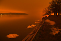Cold Dreaming (SunnyDazzled) Tags: longexposure snow newyork ice colors night reflections river lights colorful glow shoreline hudson riverbanks sleepyhollow tarrytown
