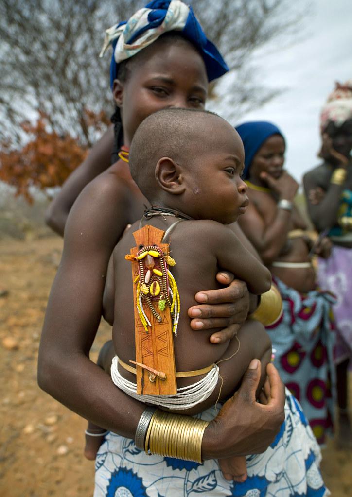 Mucubal baby and his wood talisman - Angola