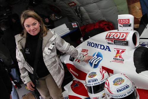 Sarah Fisher with the Indy 500 Centennial Tour themed IZOD IndyCar Series two-seater
