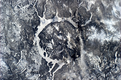 The 'eye of Quebec' or could it be modern art? (astro_paolo) Tags: canada quebec nasa iss esa internationalspacestation earthfromspace europeanspaceagency lakemanicouagan expedition26 magisstra renélevasseurisland