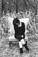 Emily P. (Grant Daniels) Tags: grant daniels photography romantic portrait bw canon 7d 50mm 14 pondering relaxed emily leaning over field grass weeds leg warmers texas usa