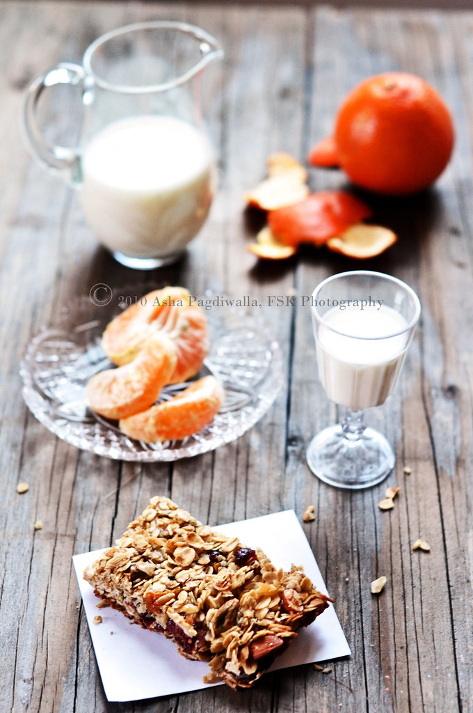Granola Bars with peeled orange
