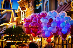 Balloons on Main Street USA at Dusk (Samantha Decker) Tags: photoshop canon balloons orlando florida adobe fl wdw waltdisneyworld postprocess themepark mk magickingdom mainstreetusa cs4 baylake canonef100mmf2usm samanthadecker wdwfolio