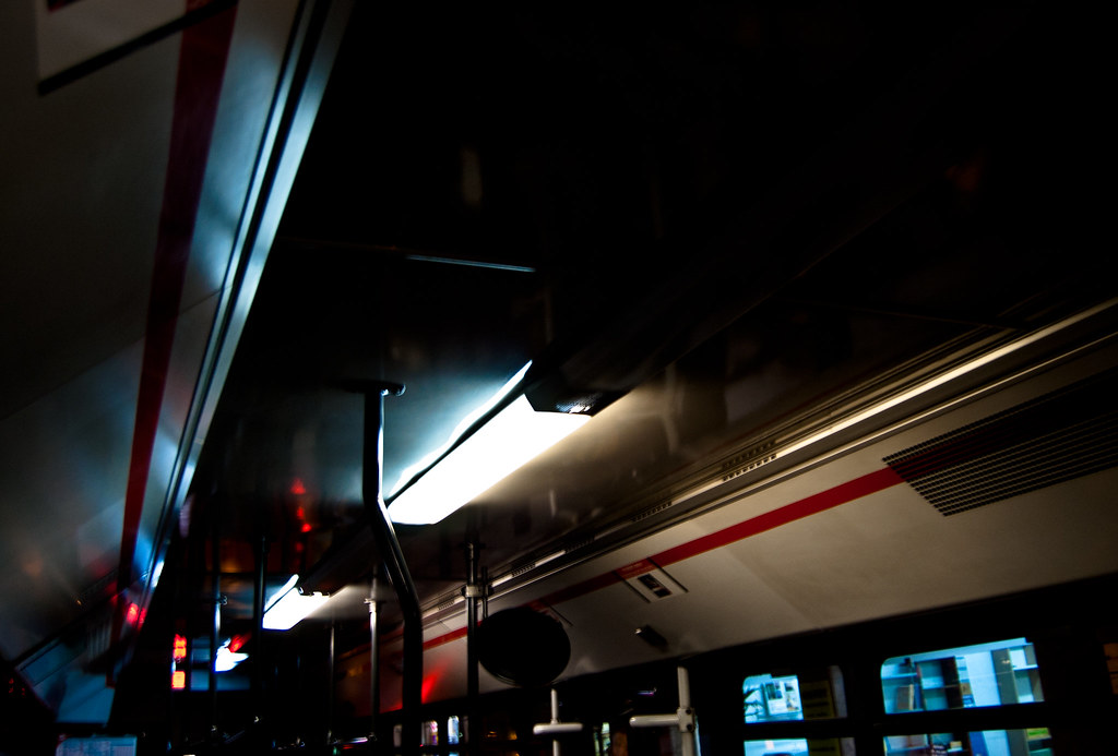 Inside of one of Barcelona's public buses. I like the cold light and red lines in this picture.