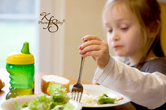 Fork (Kidzmom2009) Tags: family france cute green girl concentration eating 4 lifestyle fork hungry mealtime sippycup lefthanded preschooler eatinglunch fouryearsold lifestylephotography casualportrait gettyimageswant kidzmom2009 gettyimageswants gettywants familygetty2010 kfsphotography