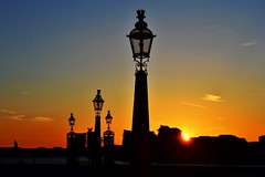 Greenwich Sunset (pallab seth) Tags: uk travel sunset england sky sun streets london tourism nature lamp silhouette thames evening spring nikon europe colours tour britain greenwich eu traveling dslr strret londoners londonist elitephotography nikon1855mmf3556gafsdxvr d3100 nikond3100 oldroyalnavalcollegecomplex