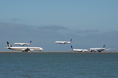 2 Boeing 777 -300 ERs, Singapore Airlines and Cathay Pacific,  and 3 Boeing 737, 757 narrow bodies. All United. DSC_0001 (wbaiv) Tags: airplane outdoor plane aircraft sfo san francisco international airport airliner jetliner jet motor vehicle heavier than air boeing 757 united airlines flight inflight aloft airborne flying intheair beacon strobe