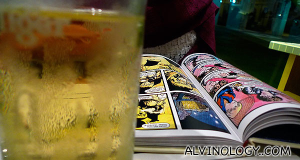 Sipping cider while reading a graphic novel