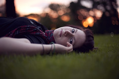 Michelle [explored] (Brendan_Timmons) Tags: park trees sunset portrait cute girl grass scarf pretty dof bokeh melbourne piercing gaze laying canon50mmf14 canon5dmkii