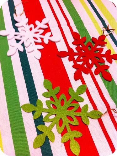 die-cut felt snowflakes