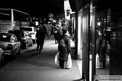 Evening shopping (Just a guy who likes to take pictures) Tags: auto voyage street city windows light portrait people urban bw en woman white black paris france reflection bus cars window glass lamp girl monochrome car shop female night shopping dark bag de jack photography lights glasses noche back store und europa europe fotografie nacht candid fenster renault plastic pack human backpack after lamps bags frankrijk brille frau zwart wit weiss isle schwarz vrouw parijs stad dunkel bril raam donker voyages zw twingo reflectie venster wagen
