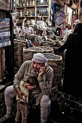 Aleppo - Souk - L' uomo al cellulare (Photos On The Road) Tags: man male mobile kid child phone adult market middleeast uomo cellulare syria souk bazaar souq aleppo verticale siria bambino mediooriente 5photosaday