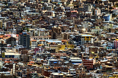 Crowded City (pantha29) Tags: color colour peru laketiticaca southamerica buildings saturated vibrant olympus andes 70300mm zuiko hdr packed crowded puno compressed e510 pseudohdr
