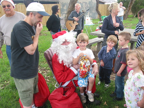 Santa Claus giving out present 03