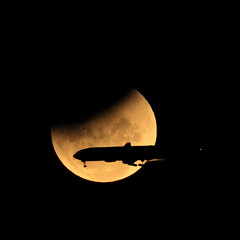 Flight of the Eclipse (David de Groot) Tags: moon silhouette canon airplane eclipse aircraft explore frontpage partialeclipse canonef400mmf56lusm canonef14xteleconverter 1dmkiv