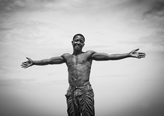 """""""I am Cristo Rei ! """" - Benguela Angola (Eric Lafforgue) Tags: africa man tourism beach muscles happy african joy culture tribal tribes blackpeople tradition tribe ethnic tribo homme angola ethnology tribu tourismo herero torsenu angolan ethnie hereros   00365       southangola"""