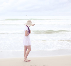 Are you Dreeeaaaming?? Dreaming... Dreaming... I wouldn't know of those things (AnnuskA  - AnnA Theodora) Tags: ocean sea portrait white selfportrait beach water girl muscles hat clouds 50mm sand waves moody dress strong highkey