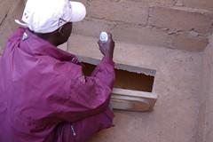Laying of a squatting pan (Sustainable sanitation) Tags: construction mud pipe adobe blocks pan vault household slab burkinafaso squatting uddt