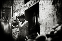 Praying in Via Dolorosa (Dan Uneken_) Tags: street woman man israel cross jerusalem prayer praying christian viadolorosa stations devout