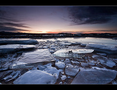 Shattered ice (Arnar Bergur) Tags: sunset sun ice clouds sunrise canon landscape 5d 1740 sk s klaki