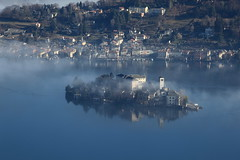 Isola di San Giulio (Guido Barberis) Tags: morning italien italy panorama lake nature fog canon landscape lago photography eos is photo interesting san flickr italia day foto photographer mark no foggy natura piemonte ii e belle l 5d usm fotografia nebbia paesaggi 70200 guido ef paesaggio maurizio fotografo isola giulio fotografi verbano mattina pella immagine obiettivo cavalletto fotocamera 24105 1635 piemont orta novarese vco novara ossola inquadrature cusio alzo nebbioso anawesomeshot colorphotoaward flickraward canoniani canonisti piemontesi novaresi flickrunitedaward allegrisinasceosidiventa flickrsportal anawsonmeshot dopaglio