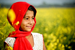 Joy is not in things; it is in us. (Megher_desher_meye) Tags: red portrait people sun white tree green nature girl yellow lights women asia colours child petal ttl bangladesh tora mustards canon500d 50mmprime manikganj nimmy mustardfields