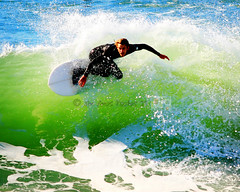 Surfing in Surf City 3 (Jason Bogs) Tags: ocean california ca blue sun jason green beach water canon colorful surf pacific bright surfer huntington wave sunny jim surfing pop pacificocean surfboard bogs amos huntingtonbeach hb canonef300mmf4lisusm ef300mmf4lisusm jimamos jasonbogs