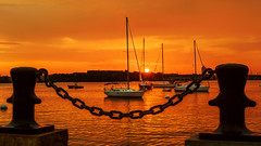 Sunrise over Boston Harbor (Insite Image) Tags: boston harbor sunrise boat water orangesky chainlink rope mooringbollard bollard longwharf massachusetts sailboat waterfront insiteimage