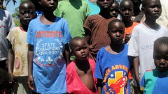 Orphans in their new clothes (dreamofachild) Tags: poverty children village african poor orphan orphanage uganda humanitarian villagers eastafrica pader ugandan northernuganda kitgum humanitarianaid aidsorphans waraffected childcharity lminews