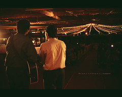 While they sang for them... (© C H A I T U) Tags: light india canon lights bride evening back engagement candid wide ring christian hyderabad hyd frm marrigae