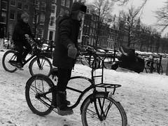 winter in amsterdam (wojofoto) Tags: amsterdam snow sneeuw schnee winter streetphoto straatfoto 2010 december stadsarchief wojofoto wolfgangjosten zwartwit monochrome blackandwhite people mensen