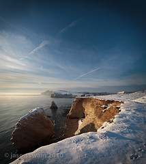 Golden hour in the snow at Freshwater Bay, Isle of Wight. (s0ulsurfing) Tags: ocean uk blue winter light sunset shadow sea england sky cloud snow cold e
