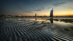Ripples (momentaryawe.com) Tags: sunset orange reflection wet water hotel sand dubai dusk uae middleeast mosque emirates burjalarab ripples luxury jumeirahbeachhotel d300s catalinmarin momentaryawecom