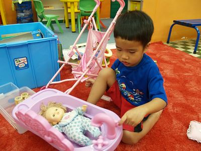 Julian at the toy library