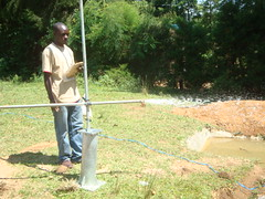 Ebusyubi primary school-BWP Worker recording results during Test pumping phase