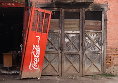 One Painted Door (cormend) Tags: door wood old city travel nepal red brick sign canon eos pain asia cola painted coke kathmandu oldtown coca leaning lean 50d cormend